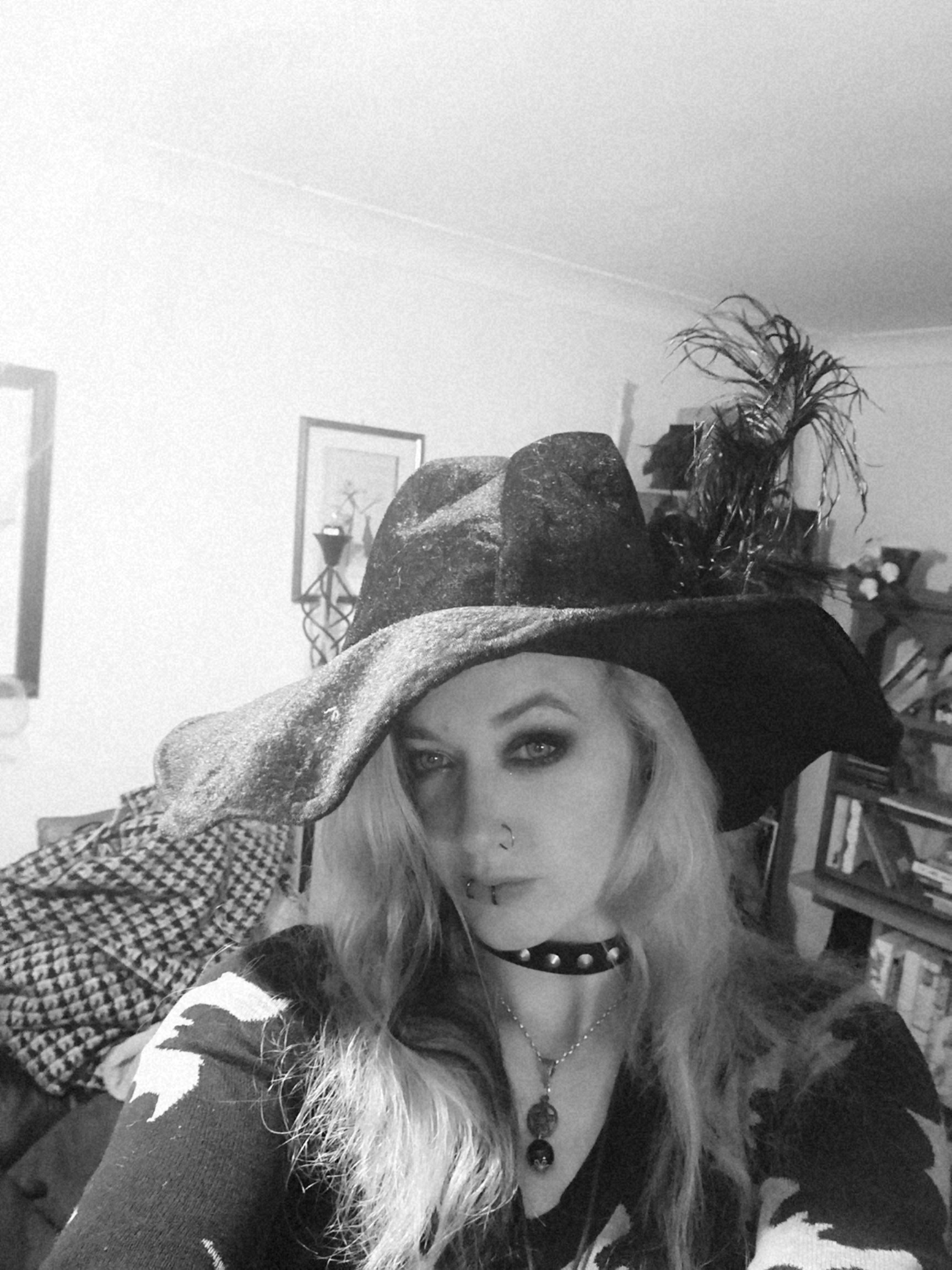 A woman wearing a witch hat
