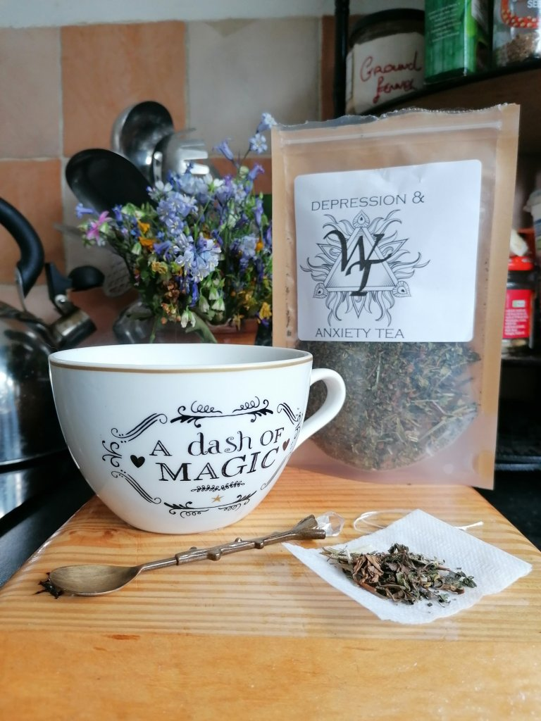 witches tea, cup, spoon and blend