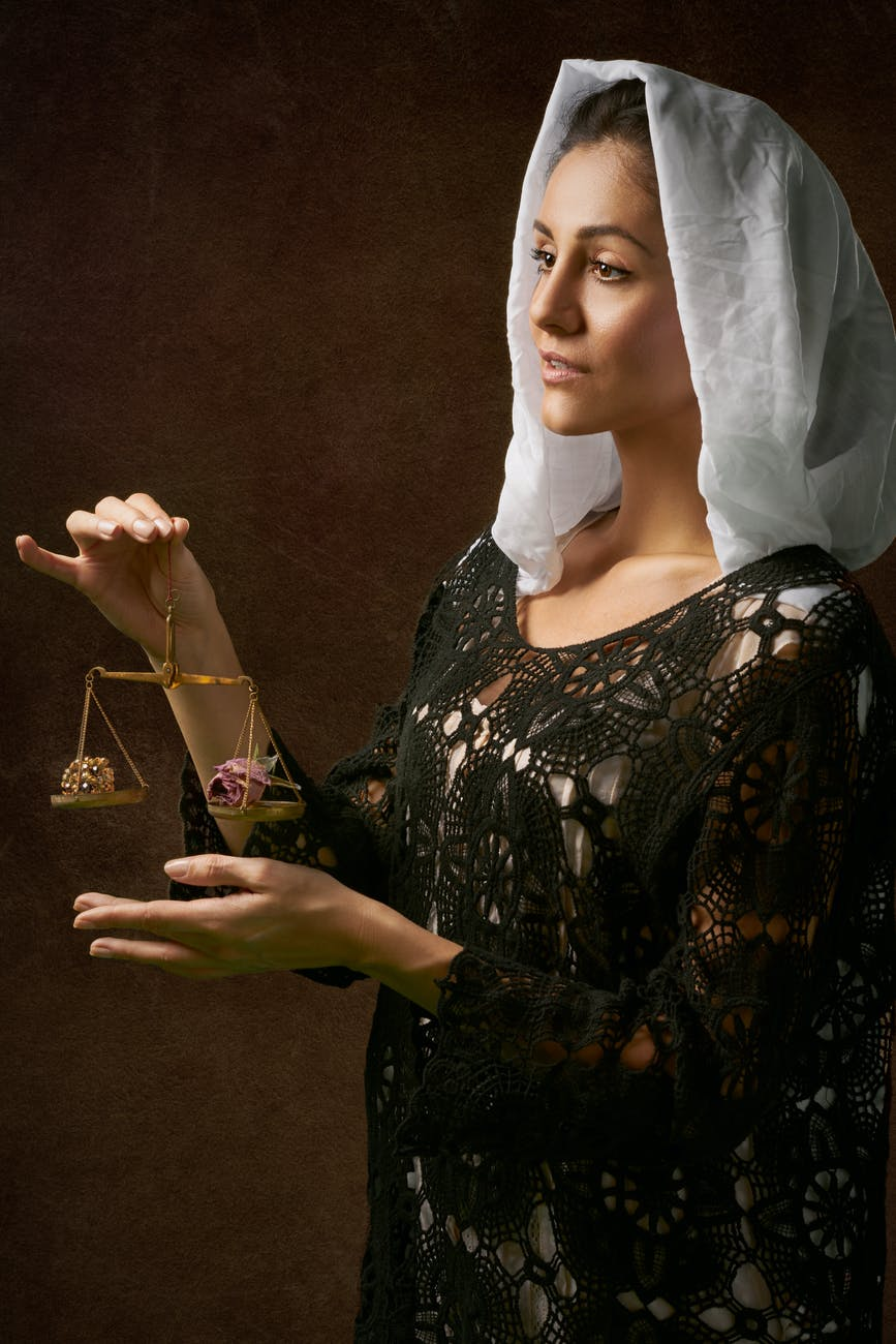 Woman holding scales